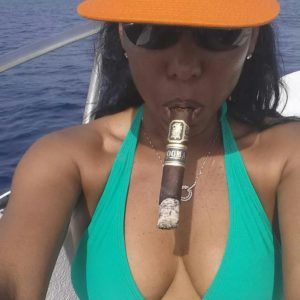 sexy woman smoking a cigar